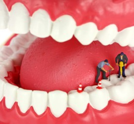 Miniature workers drilling teeth